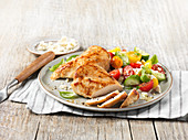 Baked chicken breast with vegetable salad