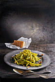 Macaroni with green pesto, cashew nuts and parmesan