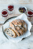 Crusty olive bread and red wine