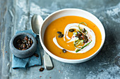 Pumpkin and apple soup with pumpkin seeds