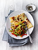 Emmer wheat pancakes with a pepper and leek medley