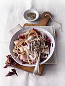 Rice spaghetti with smoked salmon trout and radicchio