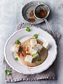 Diced yoghurt on cinnamon sabayon