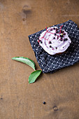 A cupcake with elderberry frosting
