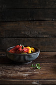 Oven-roasted pepper in a bowl against a wooden background