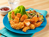 Fried prawns in breadcrumbs with salad