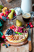 Pie with quark fillig and different fruit and berries