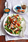 Salad with figs, feta, cranberry and almonds plus walnuts fried with honey