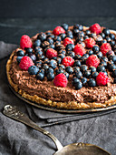 Raw vegan gluten-free chocolate tart with berries