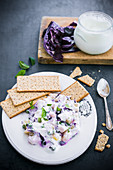 Red cabbage salad with peas and yoghurt dressing