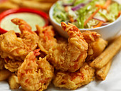 Deep-fried prawns with fries and salad