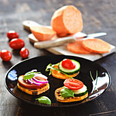 Sweet potato toasts with fresh vegetables as canapés