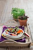 Fischfrikadellen mit Wurst und Gemüse