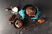 Chocolate muffins filled with chocolate cream and blueberries