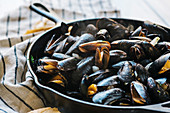 Cooked mussels in a cast-iron pan