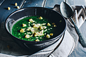 Spinach soup with feta and croutons