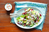 Avocado, cucumber and radishes salad with kefir dressing with chili and herbs