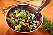 Vegan black bean salad with pepper and pumpkin seeds