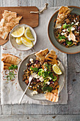 Lentils with feta cheese, lemons and unleavened bread (Greece)