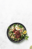 Lamb with olive and cauliflower pilaf