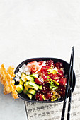 Tuna poke bowl with avocado and sesame seeds