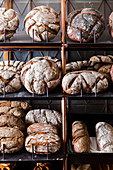 Artisan wood-fired bread loaves on shelves