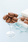 Chocolate macarons in a long-stemmed glass