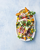 Sweet potato salad with sweetcorn and red onions