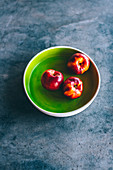 Nectarines in a green bowl