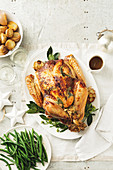 Roast turkey with bacon and tarragon stuffing for Christmas