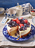 Sponge cake with orange yoghurt cream and berries