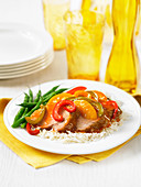 Pork with peaches, peppers, green beans and rice