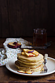 A stack of peach pancakes
