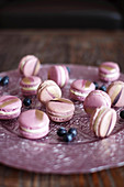Blueberry macaroons decorated with gold