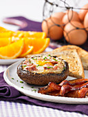 Portobello stuffed with egg and bacon
