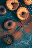 Doughnuts with chocolate glaze and cocoa powder