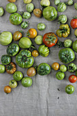 Colourful tomatoes on a linen surface