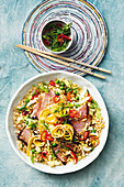 Fried rice with glazed ham and vegetables