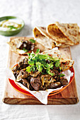 Spicy chicken livers with flatbread