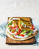 Naan bread with yoghurt, salad, and curry minute steaks