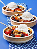 Summer berry crisp with ice cream