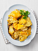 Roast potatoes with melted cheese