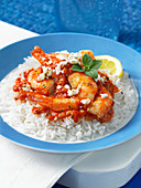 Shrimp with tomato and feta on rice