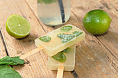 Mojito ice lollies on a wooden surface