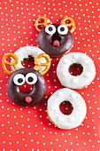 Gingerbread dougnuts decorated as reindeer and snowflakes