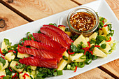Hawaiian poke bowl with raw salmon, pineapple and spring onions