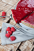Raw, vegan cashew nut cheesecake with a raspberry topping