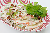Apple salad with walnuts and mayonnaise