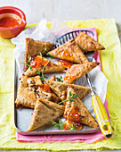 Sardine samosas and chili sauce