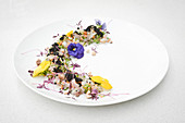 Ceviche with caviar and edible flowers
